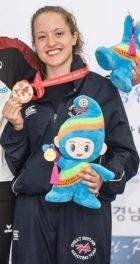 Charlotte showing off her Bronze Medal