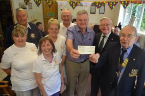 Lions President David Fowler presents the cheque to Warwick Lovegrove from the Day Care Centre